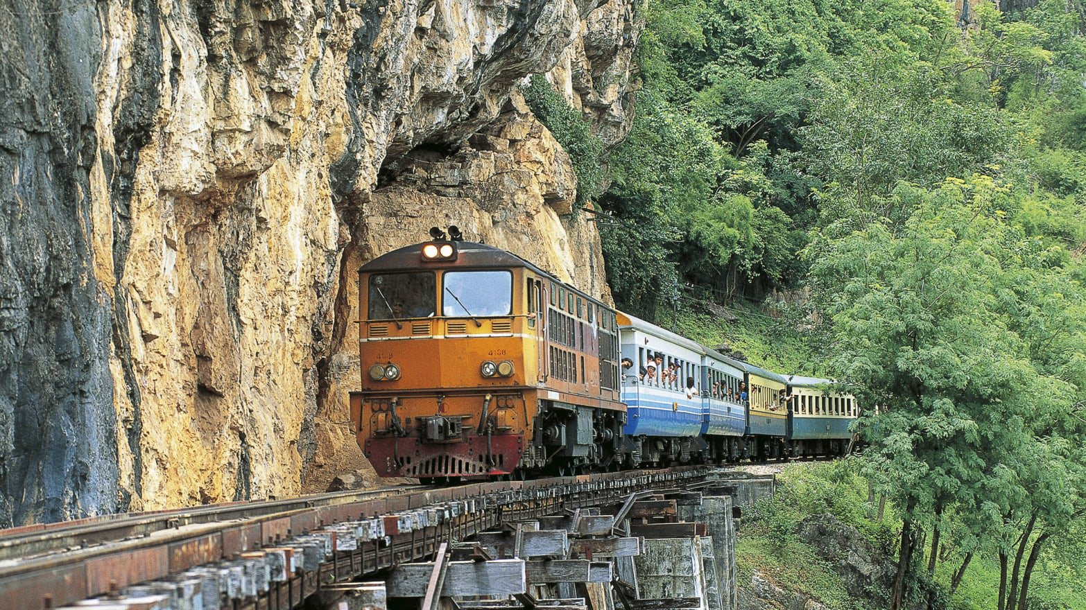 Take a historic ride on Death Railway Train passing over original wooden viaduct constructed by Allied POWs
